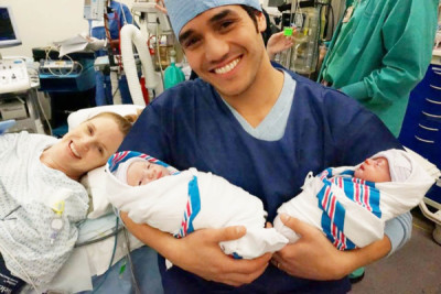 Adam Jacobs and his wife, actress Kelly Jacobs, with their new twin sons, Jack and Alex. (courtesy of Disney Theatricals)